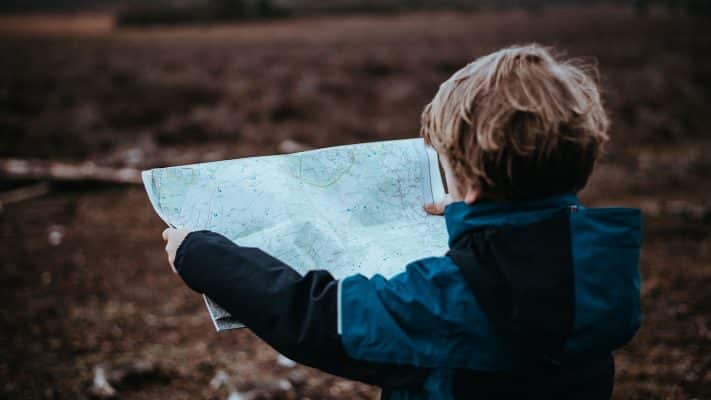Child reading map image