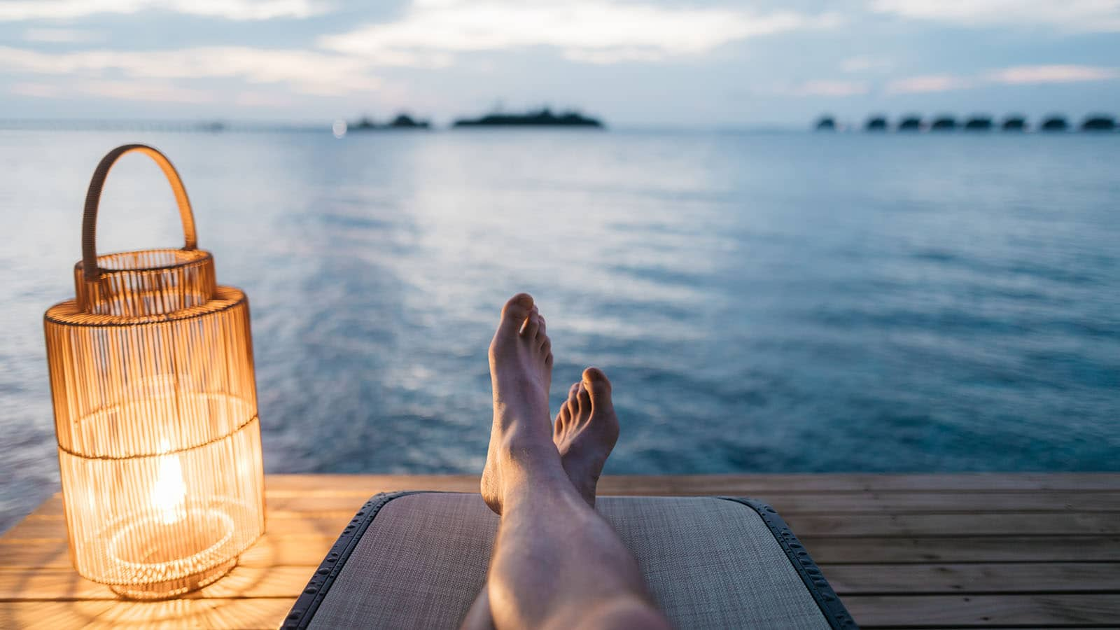 Feet relaxing near lake image